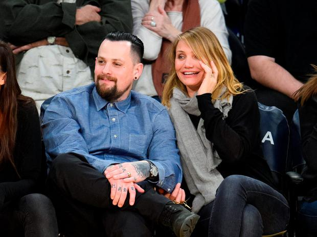 Benji Madden (L) and Cameron Diaz attend a basketball game between the Washington Wizards and the Los Angeles Lakers at Staples Center on January 27, 2015 in Los Angeles, California. (Photo by Noel Vasquez/GC Images)