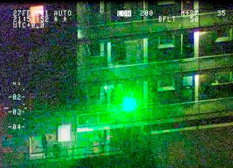 An incident in which a laser was directed at a police helicopter, leading to a man being arrested and charged. Photo: NPAS/PA Wire