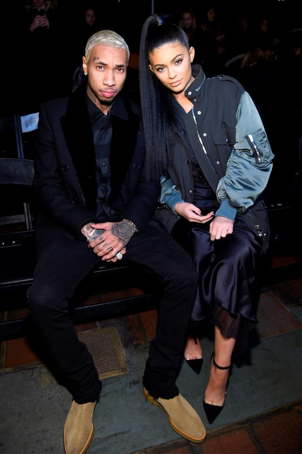 Music artist Tyga and TV personality Kylie Jenner attend the Alexander Wang Fall 2016 fashion show during New York Fashion Week at St. Bartholomew's Church on February 13, 2016 in New York City. (Photo by Jamie McCarthy/Getty Images)