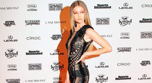 "Gigi Hadid demonstrates a ""postural expansiveness"" pose. (Photo by Jamie McCarthy/Getty Images for Sports Illustrated)"