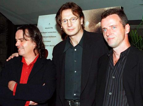 BEVERLY HILLS, UNITED STATES: Actor Liam Neeson (C) poses with co-star Aidan Quinn (R) and director Neil Jordan at the Los Angeles premiere of their film