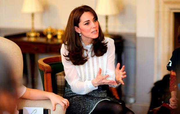 Catherine, Duchess of Cambridge talks to children from the 'Real Truth' video blog that features on the Huffington Post website at Kensington Palace