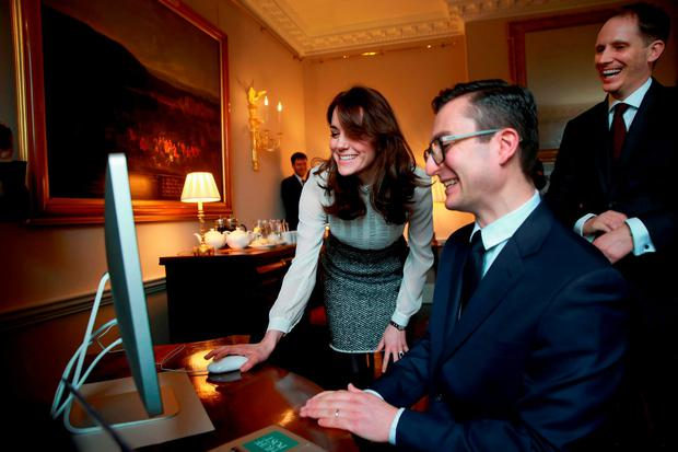Britain's Catherine, Duchess of Cambridge, (L) launches a story on 'Early Intervention in Mental Health Care' watched by James Martin, Executive Editor of Huffington Post UK, (C) and Stephen Hull, (R) Editor-in-Chief of Huffington Post UK, as the Duchess guest-edits the British edition of news website The Huffington Post at Kensington Palace