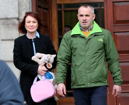 L-R: Solicitor Caoimhe Haughey with Seamus Reilly, of Swan View, Dublin Road, Navan, Co Meath pictured leaving the Four Courts after the approval of a settlement offer in a Circuit Civil Court action taken by him on behalf of his daughter, Ruth.Pic: Courts Collins