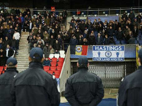 Security guards stand near the Chelsea supporters inside the Parc des Princes. Reuters