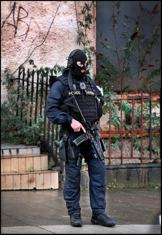 Armed Gardai on duty at the corner of Portland Row after Eddie Hutch's body was brought home Portland Row.