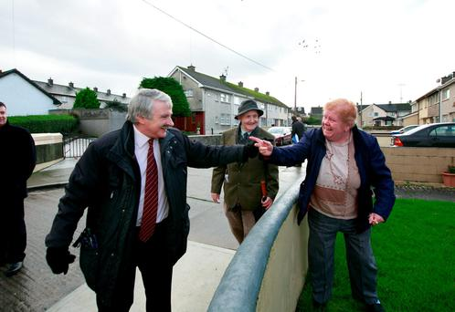 Greta Dean greets Willie O'Dea over her wall during canvassing in Garryowen, Limerick. Photo: Brian Gavin