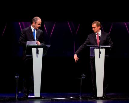 Fianna Fáil's Micheál Martin (left) and Fine Gael's Enda Kenny during Monday's party leaders' debate in Limerick; so far, the 2016 General Election campaign has not seen examples of the parties attempting to outbid each other