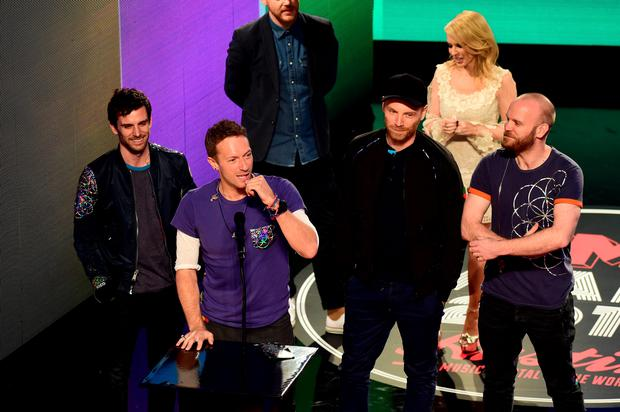 b2dc9fc57d94e Coldplay collect the Godlike Genius Award during the NME Awards 2016 with  Austin