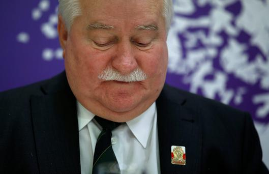 Polish 1983 Nobel peace laureate Lech Walesa looks down during the XV World Summit of Nobel Peace Laureates in Barcelona, Spain. (AP Photo/Manu Fernandez, file)