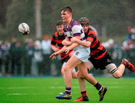 Tim O'Brien of Clongowes Wood is tackled by Chris Reynolds of Kilkenny College during their Leinster Schools Junior Cup Round 1 clash earlier this month Photo: Sportsfile