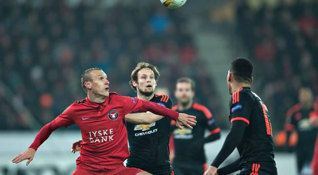 FC Midtjylland's Martin Pusic vies for the ball with Daley Blind (Getty Images)