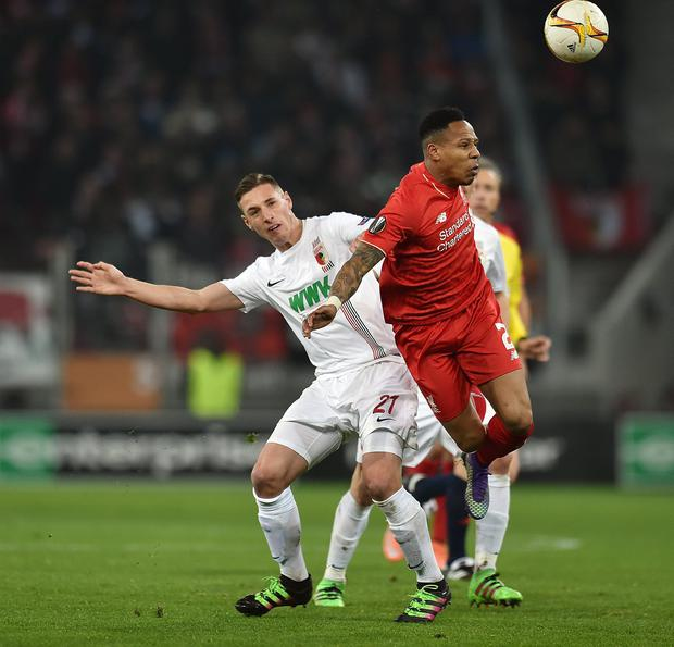 Nathaniel Clyne competes with Dominik Kohr (Liverpool FC via Getty Images)