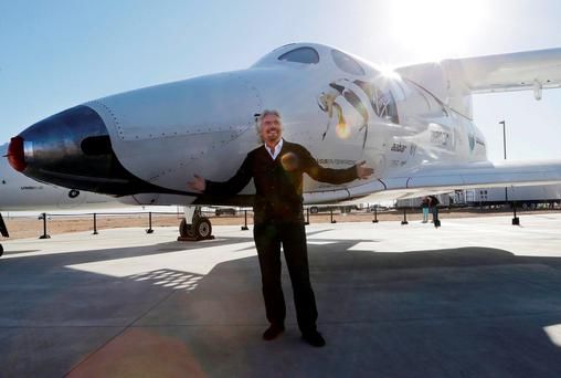 British entrepreneur Richard Branson poses with the first SpaceShipTwo at a Virgin Galactic hangar at Mojave Air and Space Port in Mojave (AP Photo/Reed Saxon, File)