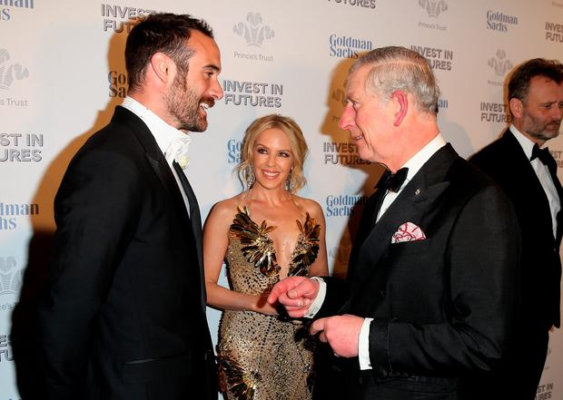 Josh Sasse, Kylie Minogue and Prince Charles, Prince of Wales attend a pre-dinner reception for the Prince's Trust Invest in Futures Gala Dinner at The Old Billingsgate