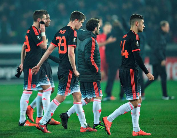 Manchester United players after their defeat in Denmark