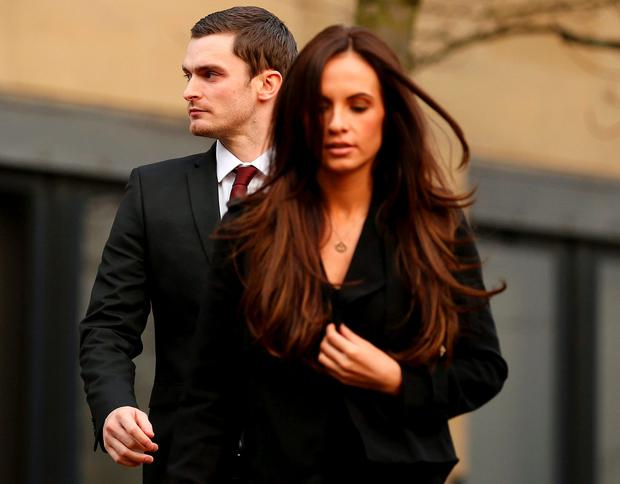 Former Sunderland soccer player Adam Johnson leaves with his girlfriend girlfriend Stacey Flounders from Bradford Crown Court in Bradford, northern England