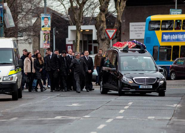 The remains of Eddie Hutch (snr) are brought to his funeral mass.