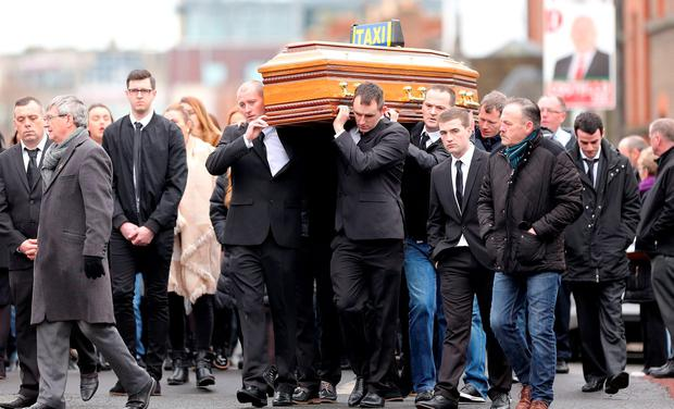 The pallbearers carry the coffin into the church at the funeral of Eddie Hutch senior who was shot dead last week.