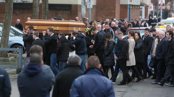 The coffin is carried to the church at the funeral of Eddie Hutch at Our Lady of Lourdes Church, Sean Mc Dermott Street, Dublin.