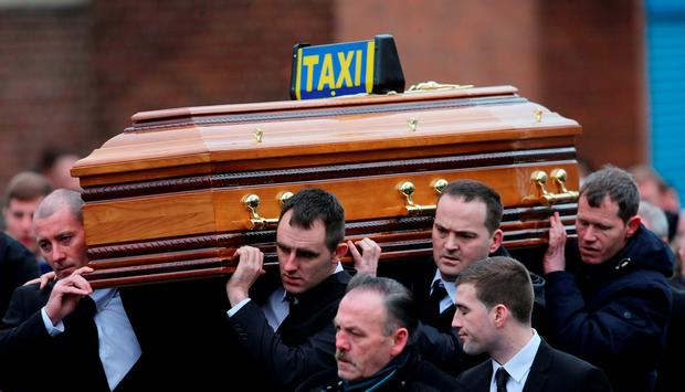 The coffin is carried into Our of Lourdes Church in Dublin for the funeral of Eddie Hutch senior who was shot dead in the north inner city last week.