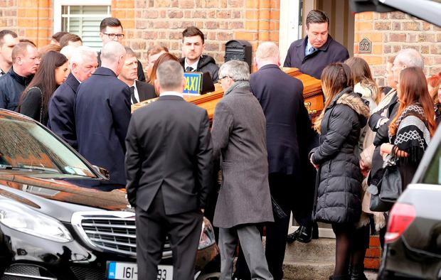 The coffin of Eddie Hutch senior is carried from his home.