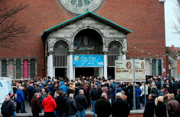 Mourners arrive at Our of Lourdes Church in Dublin for the funeral of Eddie Hutch senior who was shot dead in the north inner city last week.