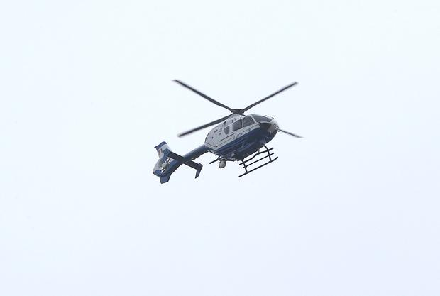 The Garda helicopter over Our Lady of Lourdes Church, Sean Mc Dermott Street, Dublin where the funeral of Eddie hutch took place.