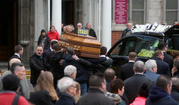 The coffin is carried to Our Lady of Lourdes Church, Sean Mc Dermott Street, for the funeral of Eddie Hutch, Dublin.