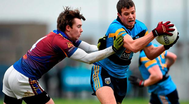 19 February 2016; Ryan Wylie, University College Dublin, in action against Patrick O'Connor, University of Limerick. Independent.ie HE GAA Sigerson Cup, Semi-Final, University College Dublin v University of Limerick, UUJ, Jordanstown, Co. Antrim. Picture credit: Oliver McVeigh / SPORTSFILE