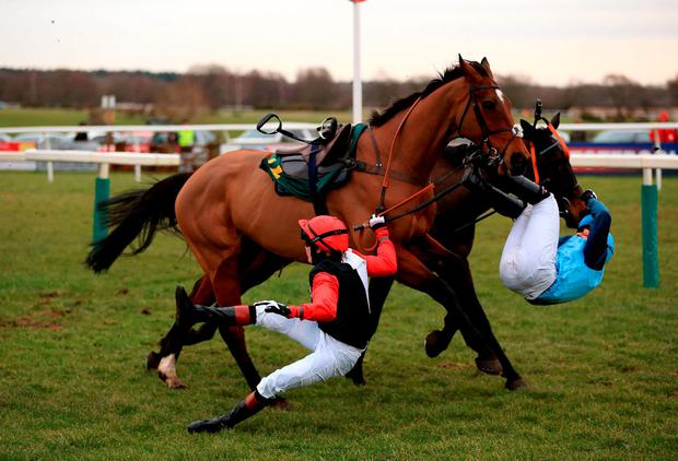 Jockey Victoria Pendleton (front) is unseated from Pacha Du Polder during the Betfair Switching Saddles 'Grassroots' Fox Hunters' Chase at Fakenham