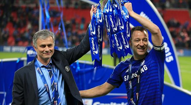Jose Mourinho with John Terry and the Capital One Cup Photo: PA Wire