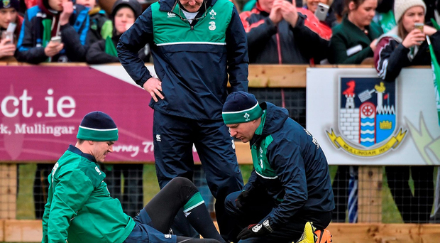 Johnny Sexton receives tratment on an ankle injury he picked up during the Irish squad session in Mullingar yesterday - the Irish No.10 is expected to be back in training on Monday. Photo: Sportsfile