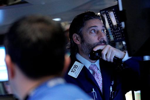 Traders work inside a post on the floor of the New York Stock Exchange. Photo: Reuters