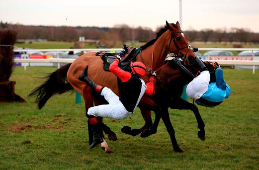 Former Olympic cycling gold medalist Victoria Pendleton (left) is unseated from hot favourite Pacha Du Polder at the same time as Carey Williamson parts company with Baltic Blue in yesterday's Betfair Switching Saddles 'Grassroots' Fox Hunters' Chase at Fakenham (Nigel French/PA Wire)