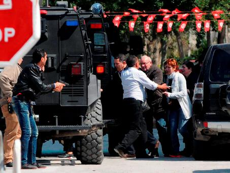Foreign tourists are evacuated from the site of the attack carried out by two gunmen at Tunis's famed Bardo Museum on March 18, 2015
