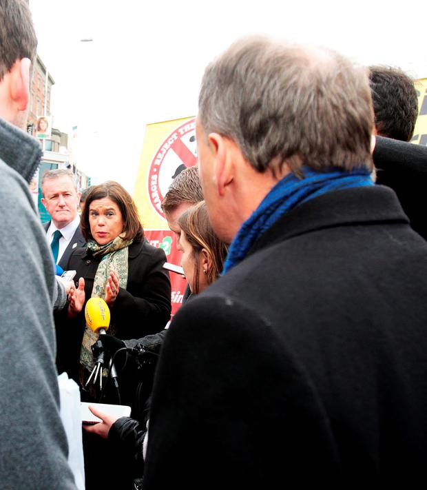 Mary Lou McDonald addresses the person, who identified himself as a small businessman, on Grafton Street (Tom Burke)