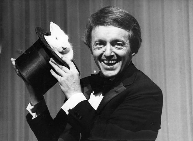 5th December 1980: British magician and entertainer Paul Daniels with a white rabbit in a hat. (Photo by Gary Stone/Central Press/Getty Images)