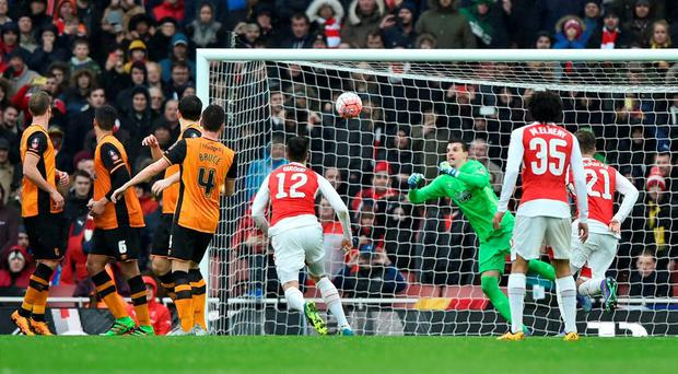 Hull City's Eldin Jakupovic saves from Arsenal's Alexis Sanchez (not pictured)