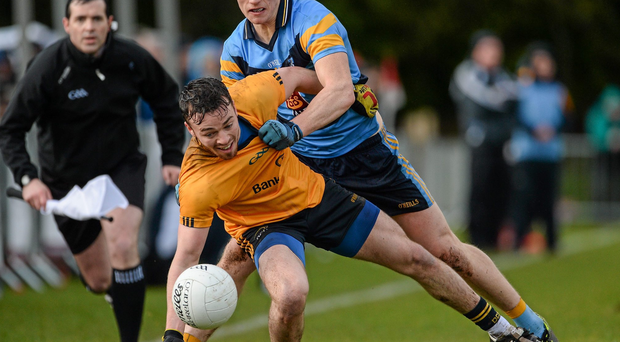 DCU's Conor Moynagh in action against John Heslin, University College Dublin. Picture credit: Oliver McVeigh / SPORTSFILE