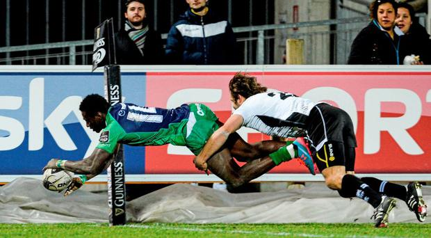 Connacht's Liyi Adeolokun goes over the line to score a try despite the tackle from Tommaso Boni of Zebre. Picture credit: credit: Max Pratelli / SPORTSFILE