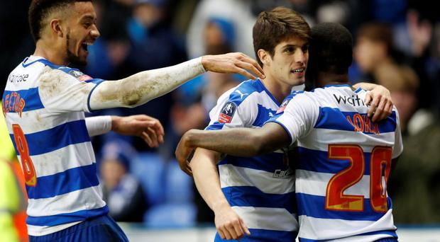 Reading's Lucas Piazon, Michael Hector and Ola John celebrate after the game