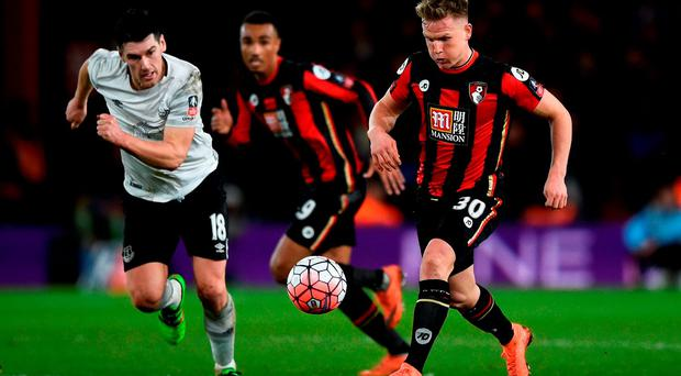 Matt Ritchie of Bournemouth and Gareth Barry of Everton compete for the ball Photo: Getty