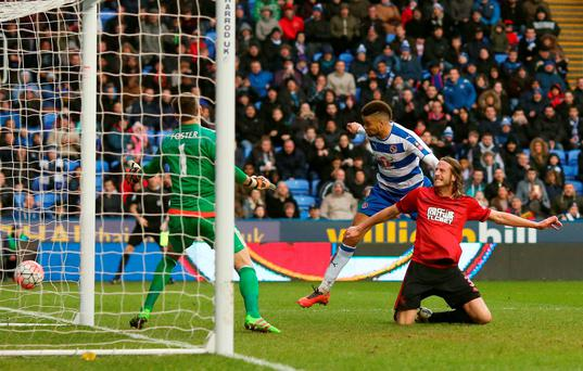 Michael Hector of Reading heads the ball to score his team's second goal Photo: Getty