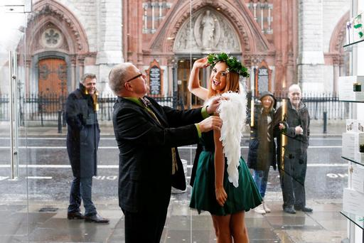 FINISHING TOUCH: Aoife Walsh with Window Doctor and former Clerys window dresser Gerhard Scully at the launch of the Go Green with Green Angel Skincare Challenge — a Guaranteed Irish-backed nationwide search to find the most creative window featuring the successful Irish skincare brand. Picture: Conor McCabe Photography