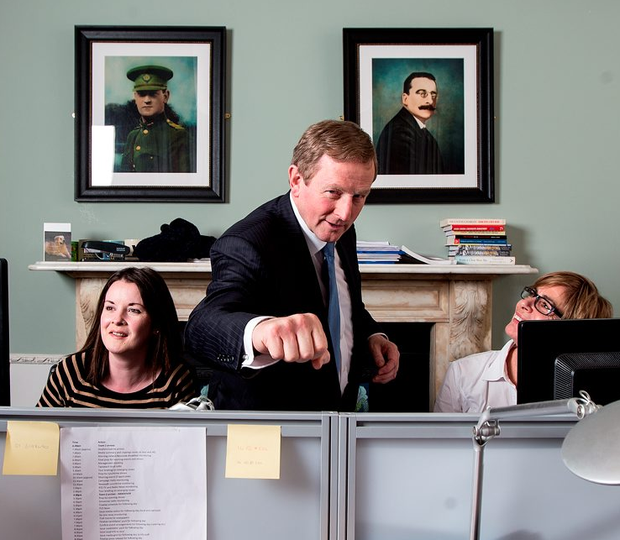 Enda Kenny greets Brendan O'Connor in the engine room of Fine Gael's head office in Mount Steet, Dublin Photo: David Conachy