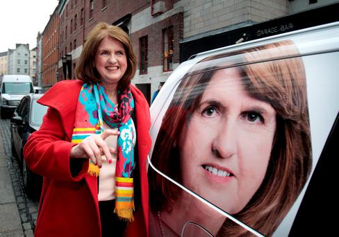 ON REFLECTION: Tanaiste and Labour party leader Joan Burton does a double take on her way into the launch of Labour's plan for Arts, Culture & Heritage named 'Standing Up for Irish Culture' which was held at the Project Arts Centre, Temple Bar, Dublin last week. Photo: Tom Burke