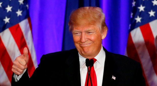 Republican presidential candidate Donald Trump gives a thumbs up during a South Carolina Republican primary night event, Saturday, Feb. 20, 2016 in Spartanburg, S.C. Trump is the winner in the South Carolina Republican primary. (AP Photo/Paul Sancya)