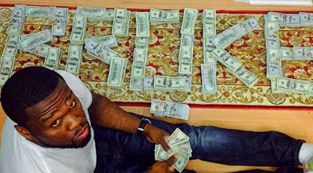 Rapper 50 Cent with his pictures surrounded by money