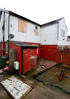 The rear of the house in Alder Street, Huddersfield, where two boys believed to be aged two and three have died after a house fire